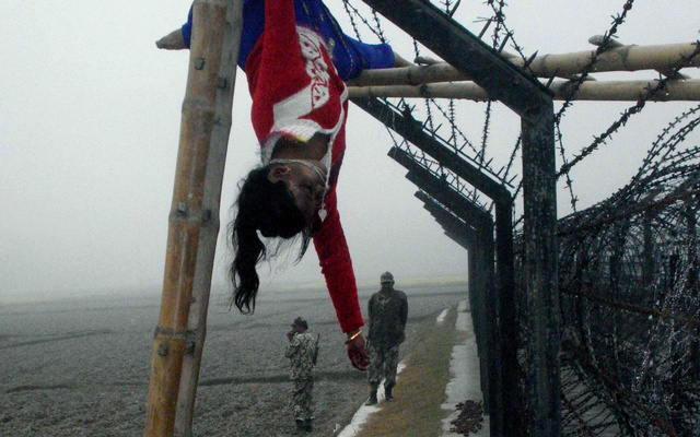 Perhaps the most recognisable image of BSF atrocities is 15-year old Felani Khatuns's body hanging motionlessly on a barbwire fence after the guards shot her on Jan 7, 2011. Photo: Shib Shankar Chatterjee