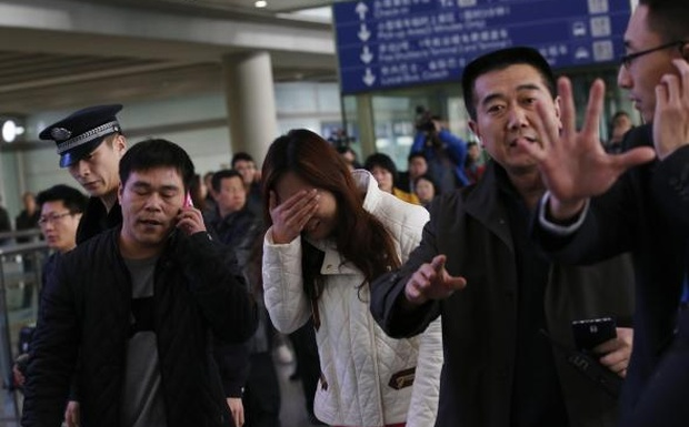 A woman relative of passenger of ill-fated plane breaks down. Photo: Reuters