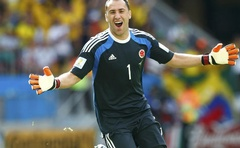 Colombia's goalkeeper David Ospina celebrates after the whistle is blown after the 2014 World Cup Group C match between Colombia and Ivory Coast at the Brasilia national stadium in Brasilia June 19, 2014. Reuters
