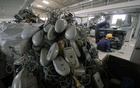 Technicians dismantle Xerox machines inside an e-waste recycle factory in India. Photo: Reuters