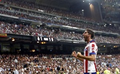 Atletico Madrid's Raul Garcia (L) celebrates after scoring a goal against Real Madrid during their Spanish Super Cup first leg football match at Santiago Bernabeu stadium in Madrid August 20, 2014. Reuters