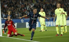 Paris St Germain's Marco Verratti (C), celebrates after scoring against Barcelona during their Champions League Group F football match against Barcelona at the Parc des Princes Stadium in Paris, September 30, 2014. Reuters