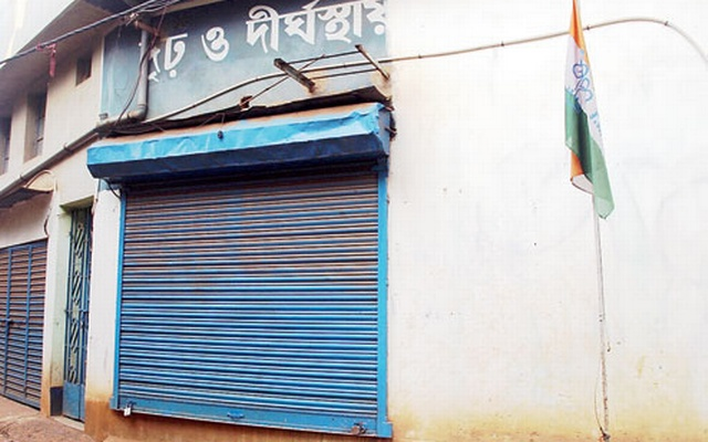 A shuttered room in the blast-hit building in Burdwan with a Trinamool flag nearby. Photo: The Telegraph