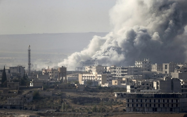 Smoke rises from the Syrian town of Kobani, seen from near the Mursitpinar border crossing on the Turkish-Syrian border in the southeastern town of Suruc in Sanliurfa province October 14, 2014. Reuters