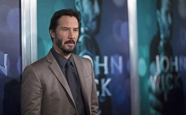 Cast member Keanu Reeves poses at a special screening of