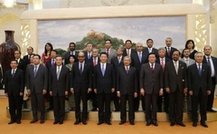 China's President Xi Jinping (C) poses for photos with the guests at the Asian Infrastructure Investment Bank launch ceremony at the Great Hall of the People in Beijing Oct 24, 2014. Credit: Reuters