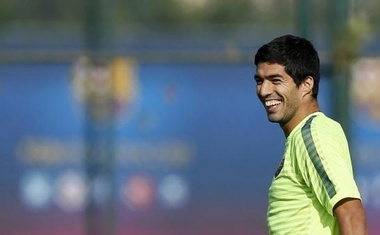 Luis Suarez smiles during a training session at Joan Gamper training camp, near Barcelona October 20, 2014. Reuters