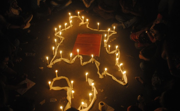 Protesters hold a candle-lit vigil demanding death sentences for all 'war criminals'