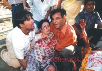 Blood-soaked Ivy Rahman after the Aug 21, 2004 grenade attacks.