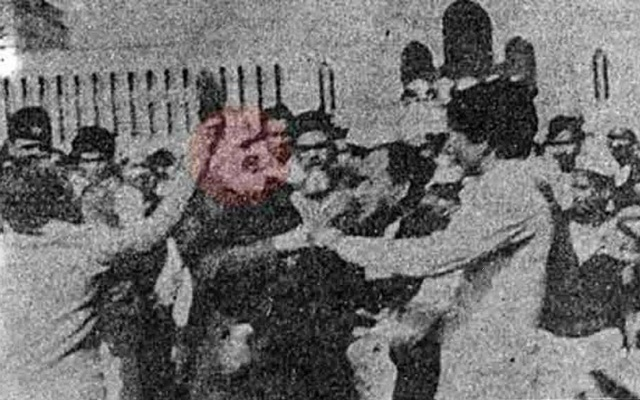 Angry people attack Ghulam Azam outside the national mosque on Jan 1, 1981