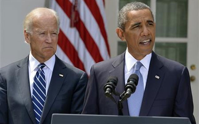 US President Barack Obama speaks next to Vice President Joe Biden (L) at the Rose Garden of the White House August 31, 2013, in Washington. Credit: Reuters/Mike Theiler