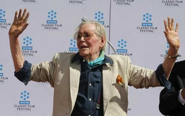 Irish-born actor Peter O'Toole displays his cement-covered hands after placing his handprints in cement during hand and footprint ceremonies honoring him at Grauman's Chinese Theatre in Hollywood April 30, 2011. Credit: Reuters/Fred Prouser