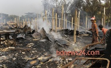 On 24 Dec 2013, during BNP-led alliance's nationwide blockade, miscreants set on fire a market at Faujdarhat in Chittagong. File Photo.