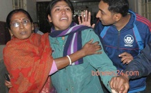 Constable Dipti Sarkar after hearing of her husband Siddharth Sarkar's injury in the bomb attack. He passed away on the night of Dec 26, 2013.