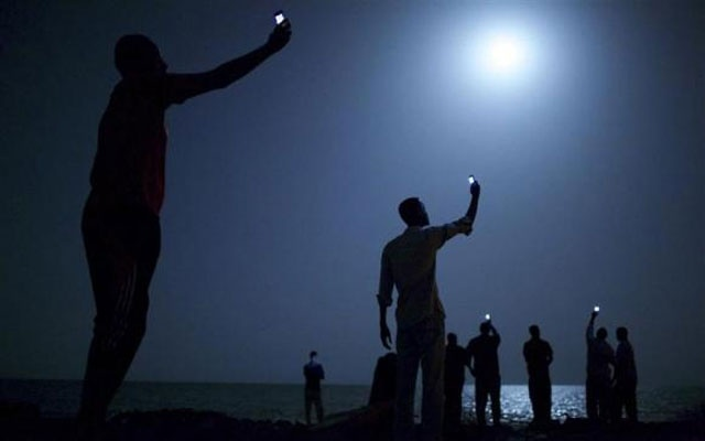 John Stanmeyer, a U.S. photographer working for VII agency on assignment for National Geographic, won the World Press Photo of the Year 2013 contest with this picture of African migrants on the shore of Djibouti city at night taken February 26, 2013. Credit: Reuters/John Stanmeyer/World Press Photo Handout via Reuters