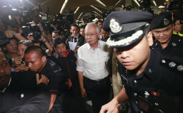 Malaysia's Prime Minister Najib Razak (C) arrives at the holding area for family and friends of passengers aboard missing Malaysia Airlines flight MH370, at Kuala Lumpur International Airport in Sepang March 8, 2014. Credit:Reuters