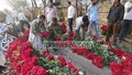 A vendor arranges his shop at Shahbagh's flower market in Dhaka on Saturday. Photo: nayan kumar/ bdnews24.com