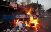 A group of Dhaka University students clash with shop owners at Nilkhet book market on Saturday evening, setting fire to shops and vandalising vehicles. Photo: bdnews24.com