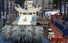 Employees of Soil Machine Dynamics (SMD) work on a subsea mining machine being built for Nautilus Minerals at Wallsend, northern England on April 14, 2014. Credit: Reuters