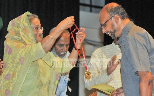 Prime Minister Sheikh Hasina hands over the Gold Medal to a fellow of the Bangladesh Academy of Sciences at the Osmani Memorial Auditorium in Dhaka on Sunday. Photo: bdnews24.com