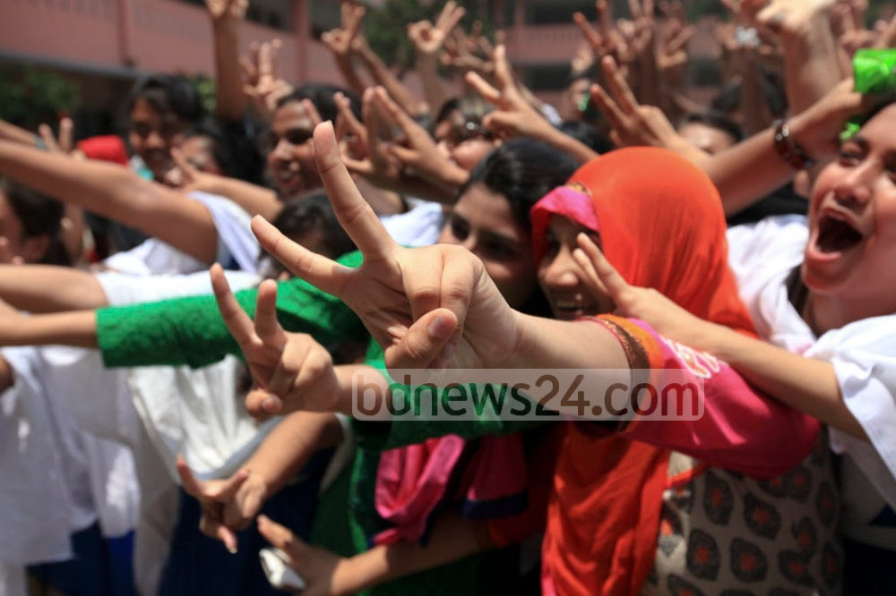 Students of Motijheel Ideal School and College celebrate after their school is placed 2nd in this year's Secondary School Certificate (SSC) exam in Dhaka Board. Photo: asaduzzaman pramanik/ bdnews24.com