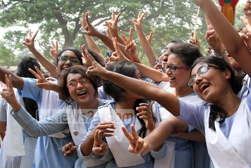Students cheer after getting the results of the Secondary School Certificate (SSC) and equivalent examinations on Saturday. Photo: nayan kumar/ bdnews24.com