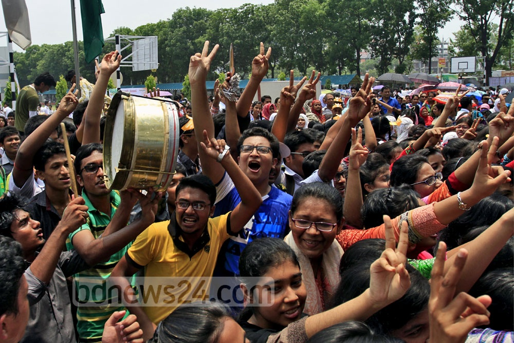Students at Rajuk Uttara Model School and College burst with joy on Saturday after topping the Secondary School Certificate (SSC) results in Dhaka board. Photo: tanvir ahammed/ bdnews24.com