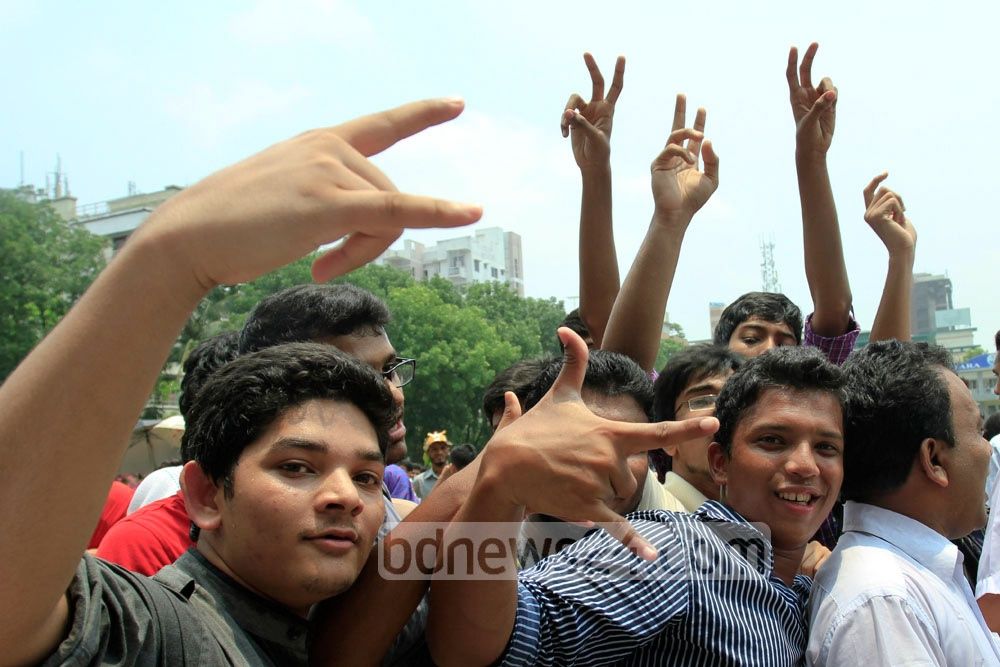 RAJUK Uttara Model College topped in this year's Secondary School Certificate (SSC) exam. The students scream with joy after results were declared on Saturday. Photo: tanvir ahammed/ bdnews24.com