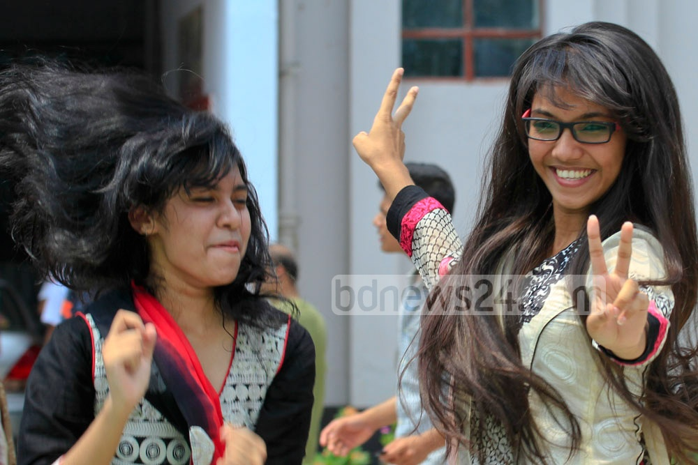 Students cheer after getting the results of the Secondary School Certificate (SSC) and equivalent examinations on Saturday. Photo: tanvir ahammed/ bdnews24.com