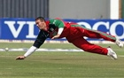 Zimbabwe's Heath Streak dives to field a ball at the Harare Sports Club, August 31, 2005. Credit: Reuters