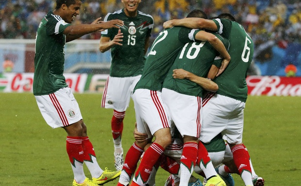Mexico's players celebrate their goal against Cameroon during their 2014 World Cup Group A soccer match at the Dunas arena in Natal, June 13, 2014. Credit: Reuters