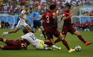Germany's Mario Goetze (2nd L) is fouled by Portugal's Joao Pereira (L) during their 2014 World Cup Group G football match at the Fonte Nova arena in Salvador, June 16, 2014. Credit: Reuters