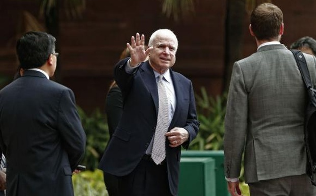 US Senator John McCain waves to members of the media after his meeting with Foreign Minister Sushma Swaraj in New Delhi July 2, 2014. Credit: Reuters