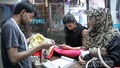 Tailors busy sewing clothes ahead of Eid. Photo taken at capital's Mirpur on Friday. Photo: asif mahmud ove/ bdnews24.com