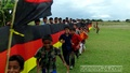 Fans of German football hold up a 750-feet flag on the banks of Padma River at Faridpur on Sunday. A Bangladesh flag flutters nearby. Photo: bdnews24.com