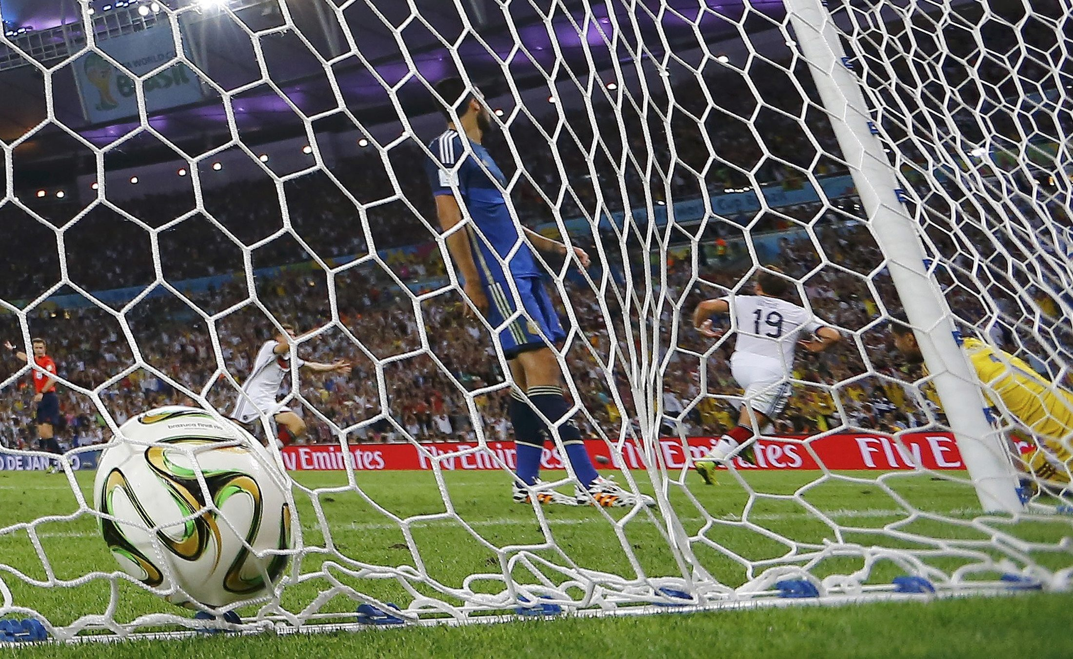 Germany's Mario Goetze (2nd R) celebrates after scoring a goal past Argentina's goalkeeper Sergio Romero during their 2014 World Cup final. Reuters