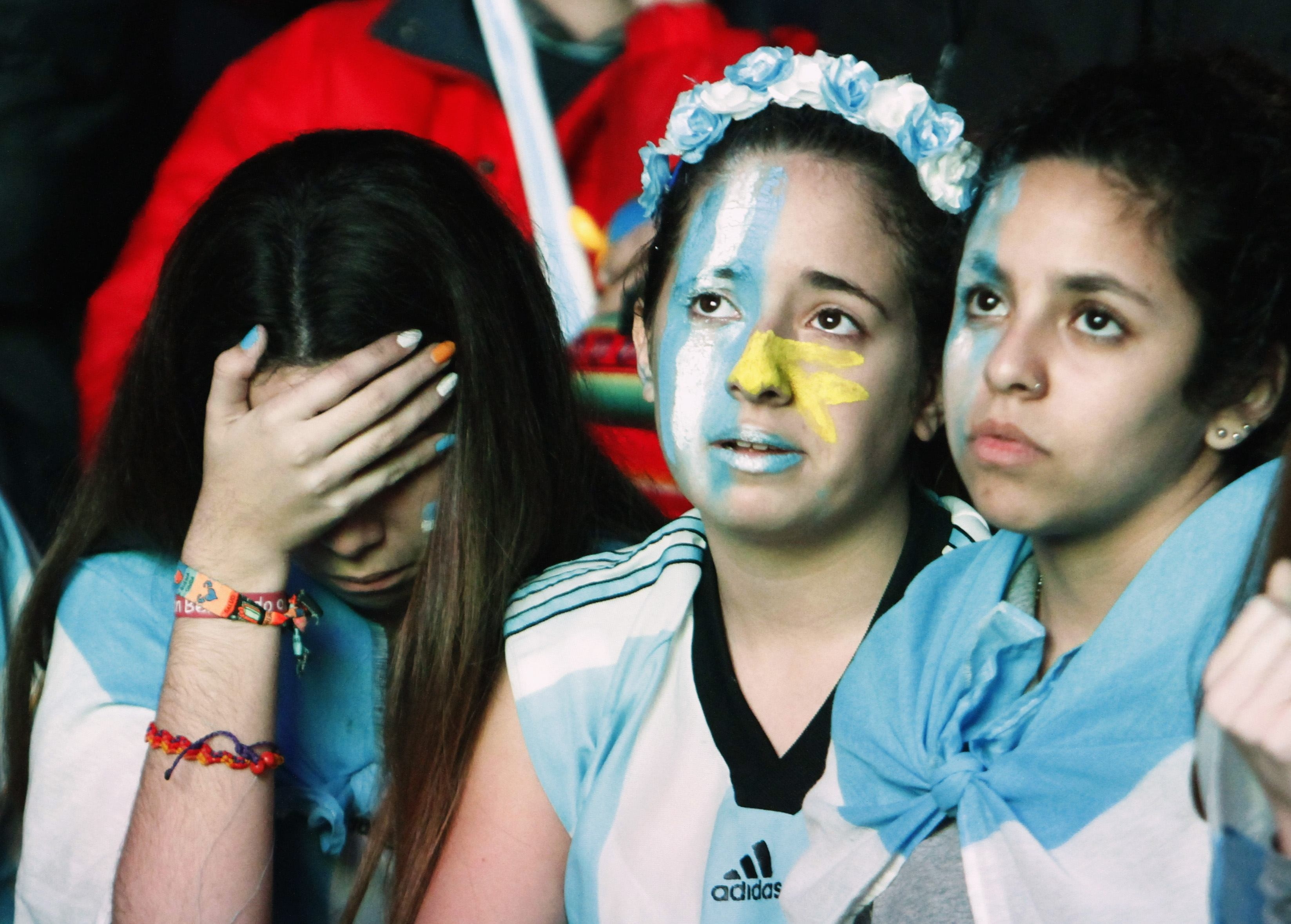 Argentina fans react after Argentina lost to Germany in their 2014 World Cup final soccer match in Brazil, at a public square viewing area in Buenos Aires. Reuters