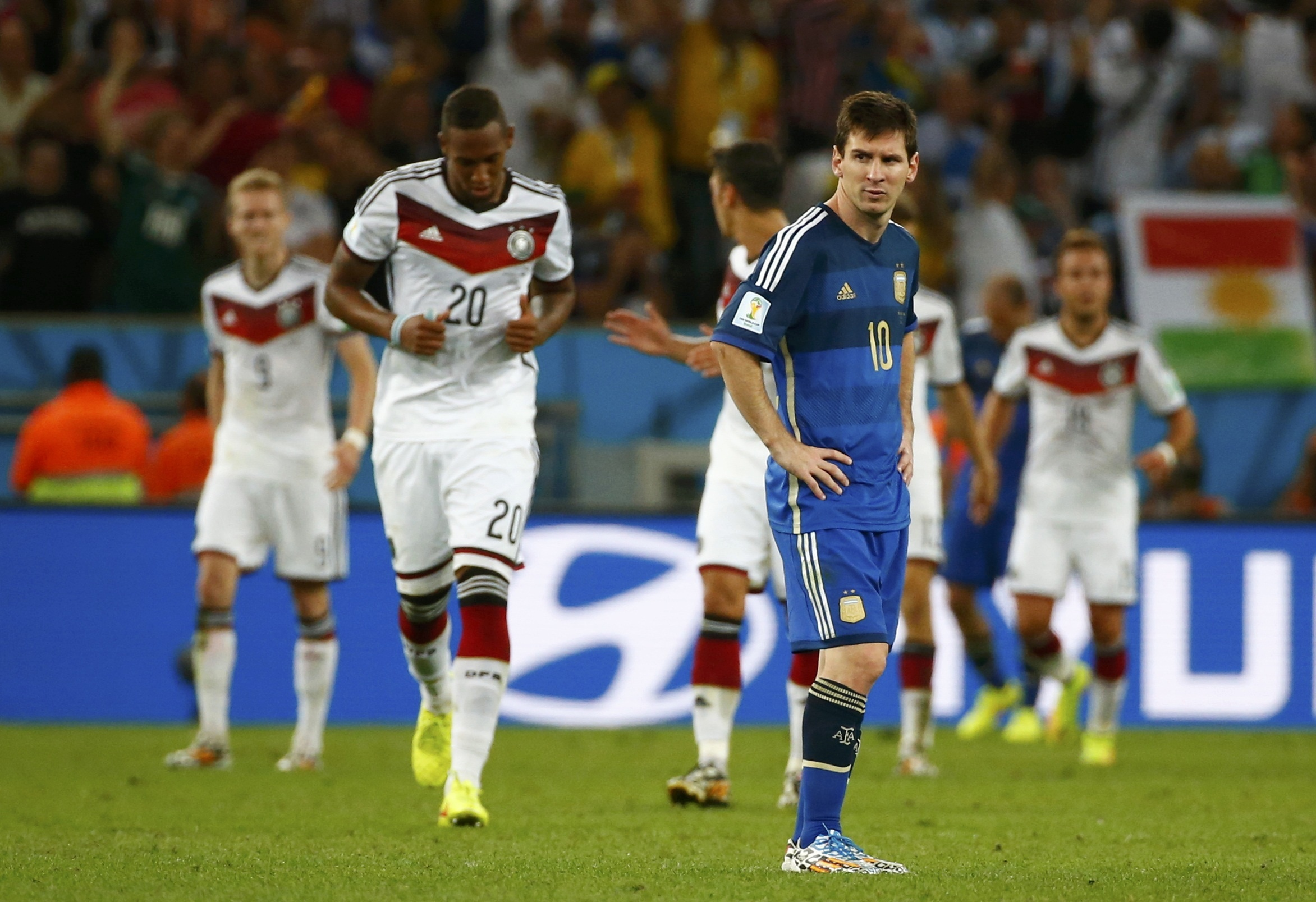 Argentina's Lionel Messi reacts as Germany players celebrate their goal during extra time in the 2014 World Cup final. Reuters