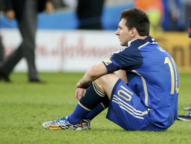 Lionel Messi sits on the pitch after losing the final against Germany at the Estádio Maracanã. Reuters