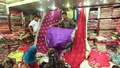Shoppers take look at clothing at Gausia Market in Dhaka on Wednesday while shopping ahead of Eid-ul-Fitr. Photo: nayan kumar/ bdnews24.com