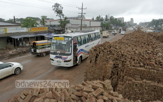 Pile of bricks, meant to repair the Dhaka-Mymensingh highway, blocking part of the highway itself at Gazipur's Chandona on Monday. Photo: tanvir ahammed/ bdnews24.com