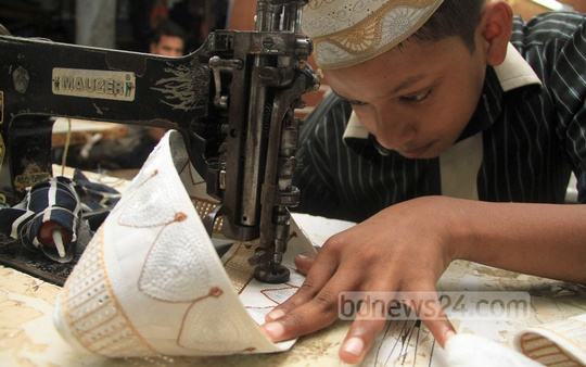 A worker busy making prayer cap ahead of the Eid-ul-Fitr at a factory in Dhaka's Lalbagh on Tuesday. Photo: asif mahmud ove/ bdnews24.com