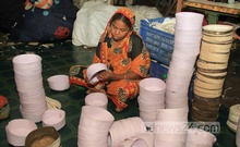 A female worker busy making prayer cap ahead of the Eid-ul-Fitr at a factory in Dhaka's Lalbagh on Tuesday.
