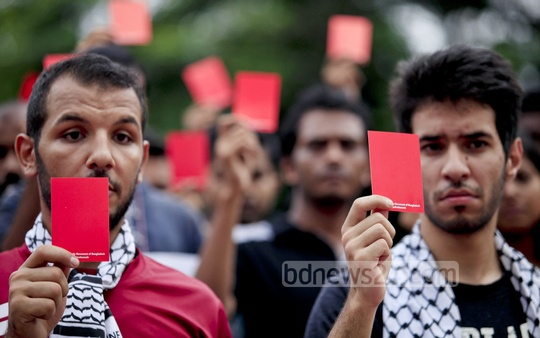 Palestinian students join a protest organised by Palestine Solidarity Movement of Bangladesh in front of the Central Shaheed Minar on Wednesday where Israel was shown the 'red card' for its attack on Gaza . Photo: asaduzzaman pramanik/ bdnews24.com