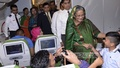 Prime Minister Sheikh Hasina exchanges greetings with fellow passengers on a Biman Bangladesh flight on her way to home from London on Wednesday. Photo: bdnews24.com