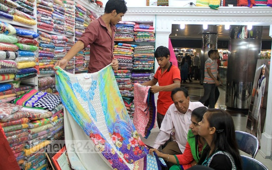 Customers choosing dresses at Bashundhara City in Dhaka on Friday ahead of Eid-ul-Fitr. Photo: asif mahmud ove/ bdnews24.com