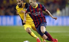 Andres Iniesta and Atletico's Arda Turan during their Champions League quarter-final first leg at the Camp Nou in Barcelona. Reuters