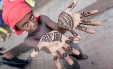 A street child is in joyous mood after volunteers of Shopnobuzz Community, a social organisation, put Hena on his hands on Saturday. Photo: asaduzzaman pramanik/ bdnews24.com