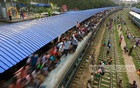 Desperate Eid-ul-Fitr holiday travellers climb on to the roof of a train at the Airport railway station on Saturday. Photo: mustafiz mamun/ bdnews24.com