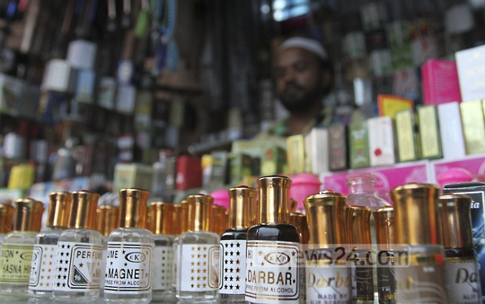 A seller arranges vials of Attar fragrance in his shop in front of Baitul Mukarram, the national mosque on Sunday. Photo: nayan kumar/ bdnews24.com